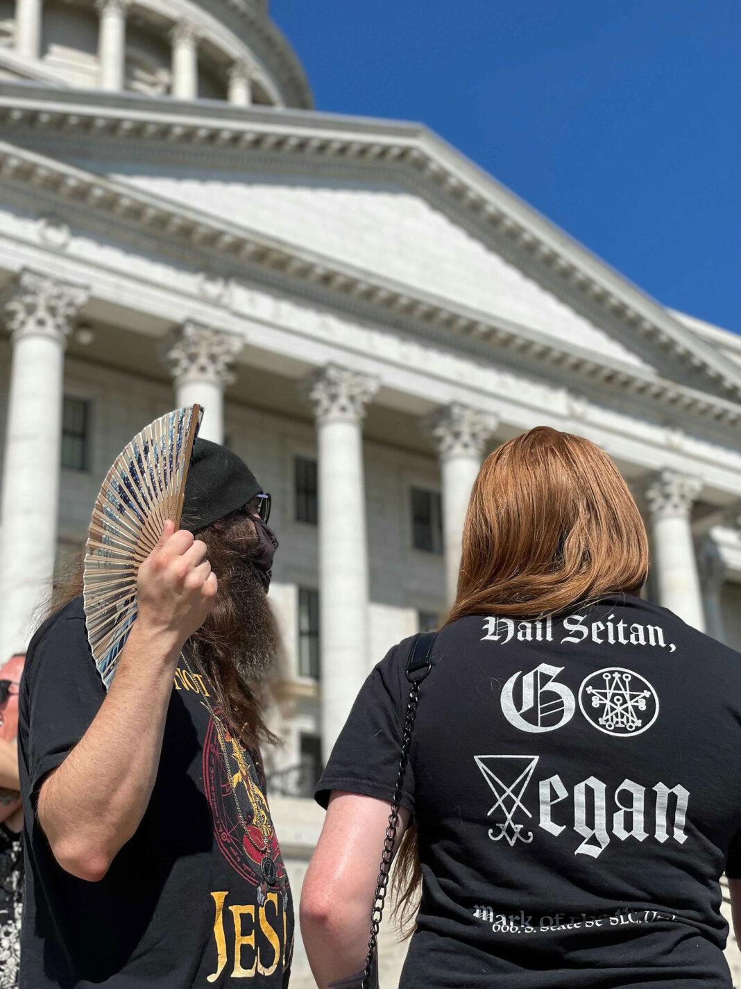 """Protester wears a shirt that reads """"Hail Seitan, Go Vegan"""""""