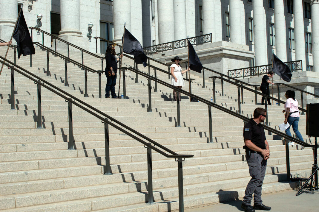 Flagbearers stand on Capitol steps
