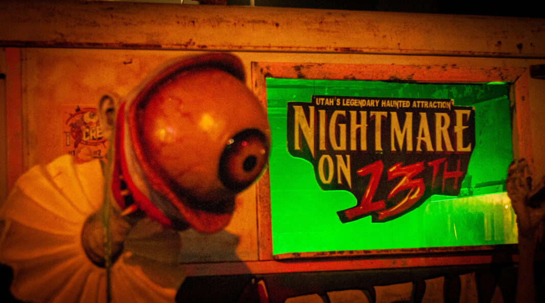 Eyeball next to Nightmare on 13th sign