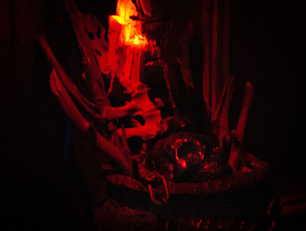 Skull and bones under candlelight