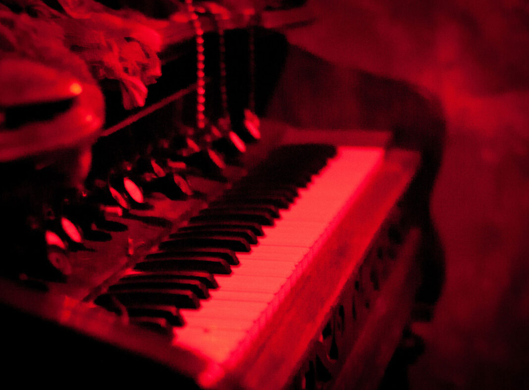 Piano under red lights