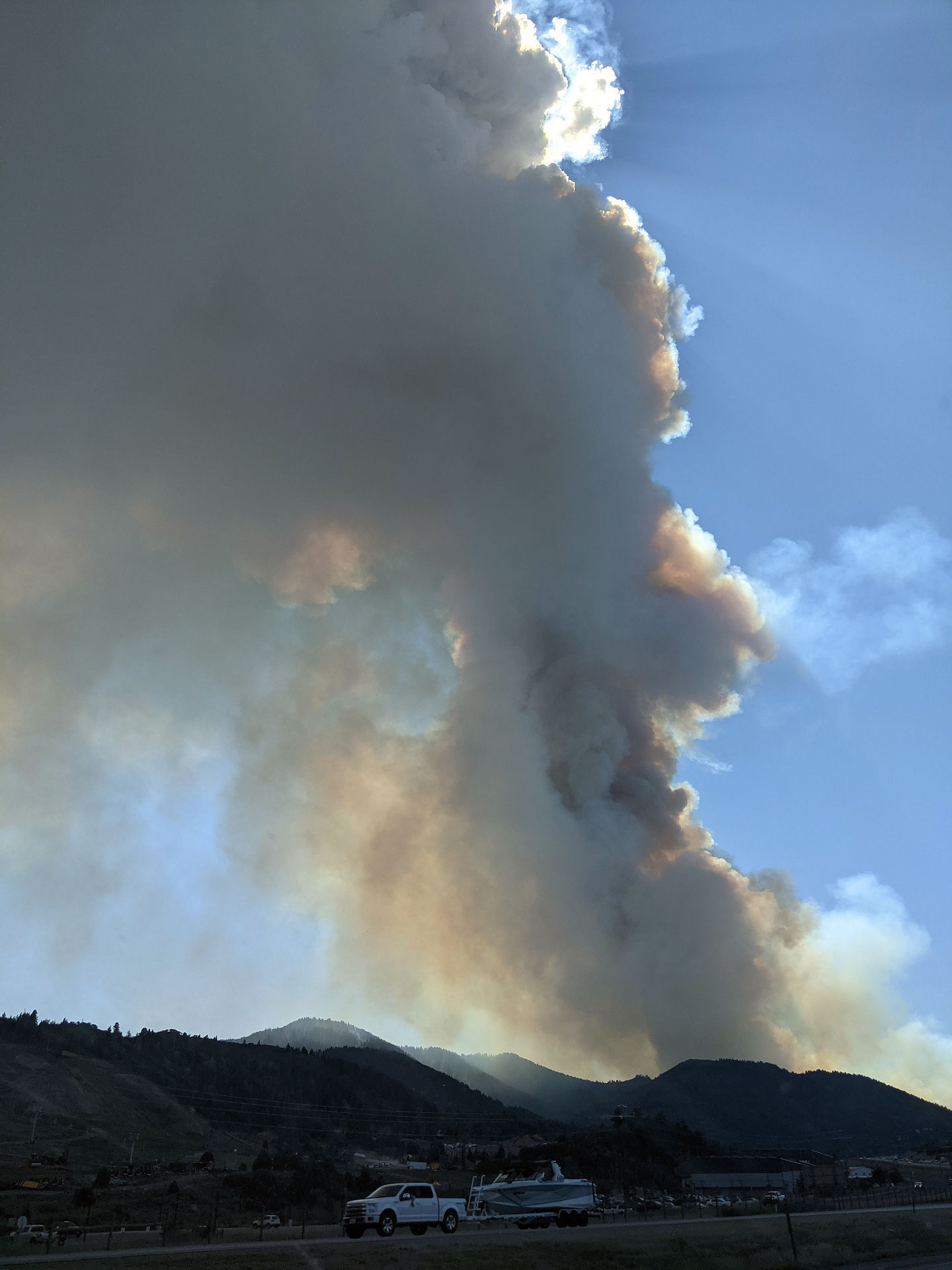 A plume of smoke rises over the mountains on I-80 in Parleys Canyon