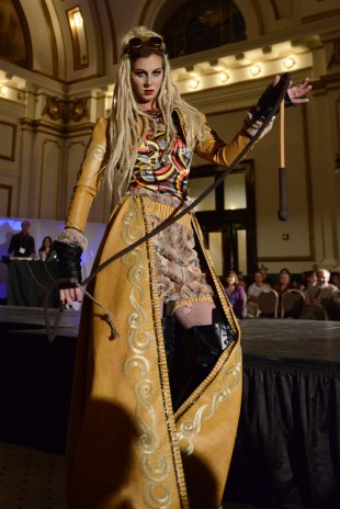 A female model sports a Steampunk-inspired outfit at a fashion show put on by the SLCC Fashion Institute
