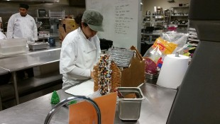 Culinary student creating gingerbread house