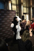 Snoopy gives a hug