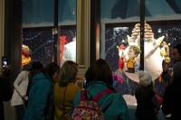 Guests look at candy windows