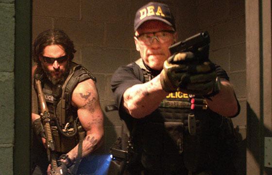 Still from Sabotage featuring Joe Manganiello and Arnold Schwarzenegger.