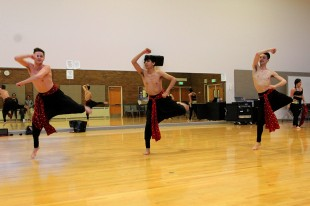 """Male dancers from the SLCC Dance Company practice a Bollywood dance during rehearsals for the fall 2014 """"Language of Dance"""" concert."""