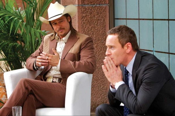 Westray (Brad Pitt, left) outlines the harsh truths of the Counselor's (Michael Fassbender) predicament.