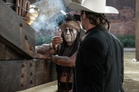Johnny Depp, left, as Tonto and Armie Hammer as the Lone Ranger