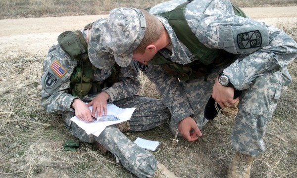 One cadet helping another during land nav