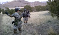 Three cadets prepare for assault exercise