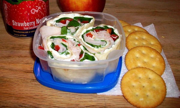 Spinach cream cheese wrap, crackers and drink