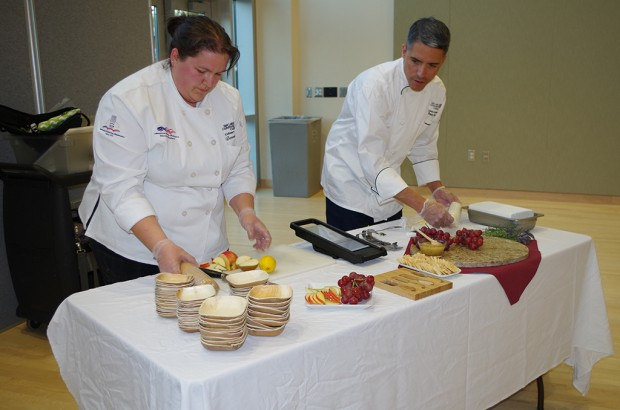 Culinary Student Donna Mills and Instructor Franco Aloia set up the display for the Cheese Challenge