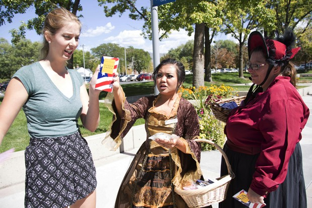Executive Vice President Justine Tabilgan and Sonia Biggers telling student Anna Roberts about Constitution Day.