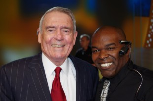 Damien Holmes, right, with Dan Rather