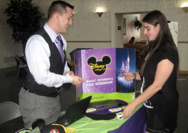 Disney representative Trent Romjin (left) and student Michelle Watson