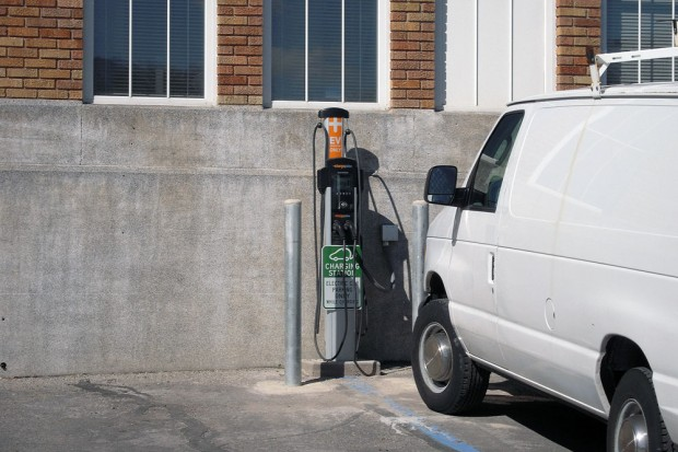 Van parked in front of charging station