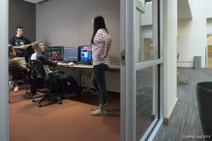 A group of students using an edit bay