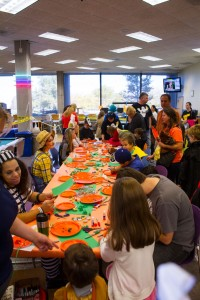 One of the many activities at the year's SLCC Holloween Carnival. Kids at this table got to design pumpkins on orange paper plates.
