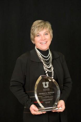 Deneece Huftalin with alumni award