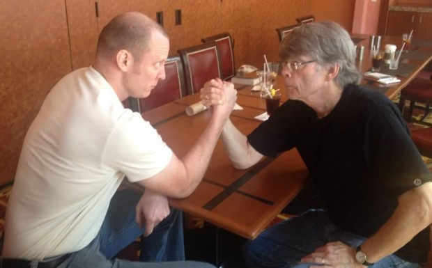 Josh Hanagarne arm wrestling Stephen King
