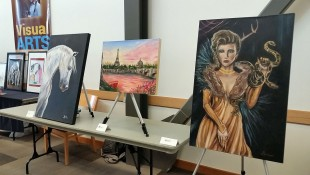 Three works of art on a table