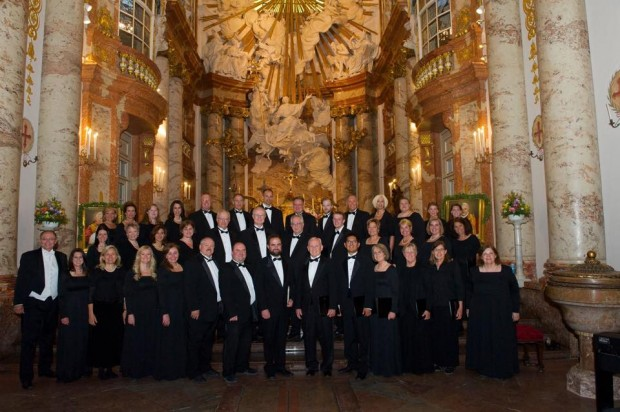 Odyssey Chorale members standing in St. Charles Cathedral in Vienna, Austria