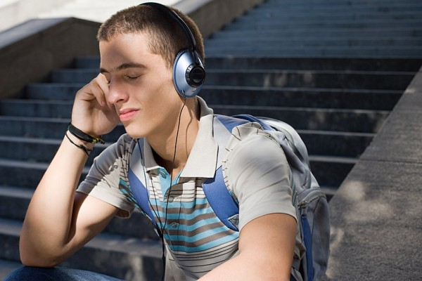 Male student listens to music on his headphones