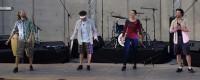Rhythmic Circus performers on stage
