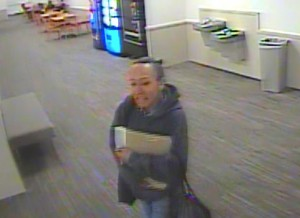Person of interest allegedly leaving scene of crime.