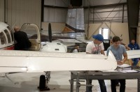 Students work in the hangar