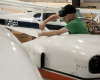 SLCC Aviation student making repairs