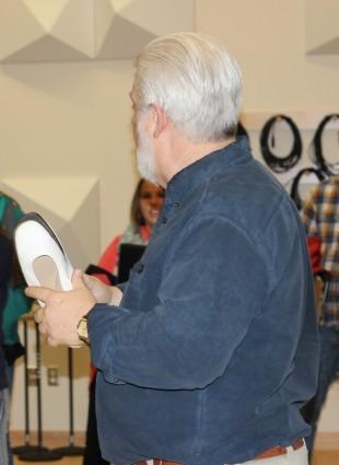 Jon Clark holds women's shoes