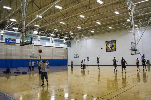 Students play basketball inside the LAC