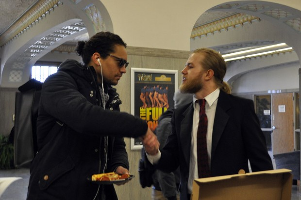 Davies Young shakes hand with a student voter