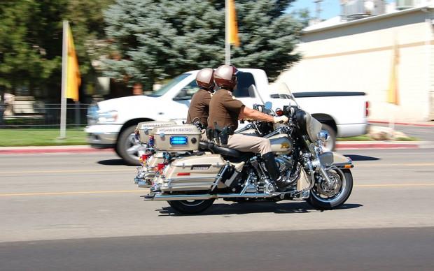 Officers from the Utah Highway Patrol speed along on their patrol bikes