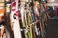 Bundles of skis leaning on store walls