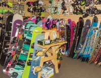 Rows of snowboards and accessories inside 2nd Tracks Sports