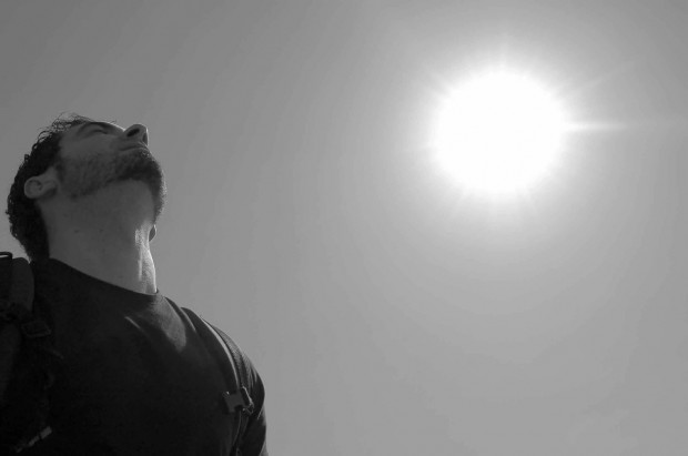 Man takes a deep breath outside
