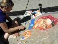 "Chelsea Baugh works on her version of ""Rosie The Riveter"""