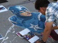 Winner of the 2011 People's Choice Award, Clayton Tycksen, works on this years piece, a full color rendition of all of the Avengers