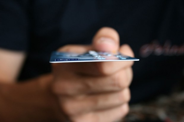 Man holds credit card