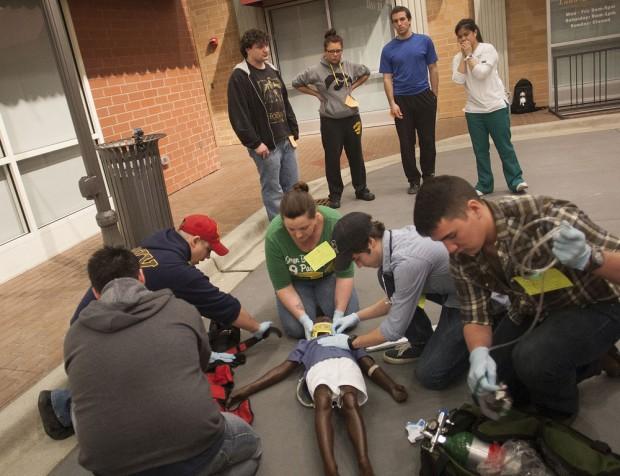 EMT students stabilize a patient