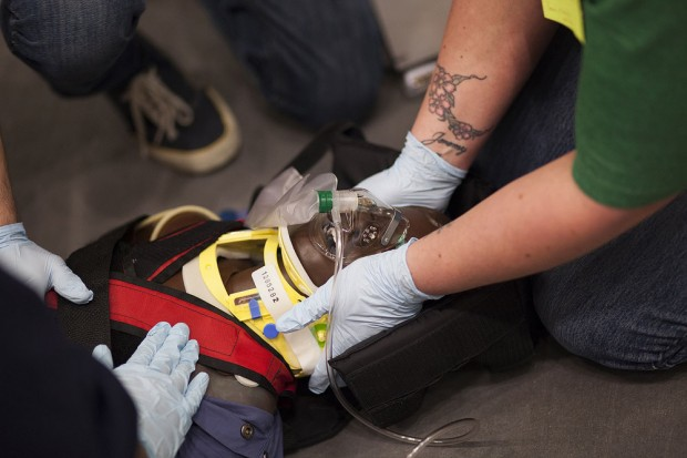 EMT students practice stabilizing a patient