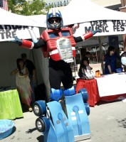 Eric Jensen of the Off Broadway Theater shows off the transformer costume he created for the Chalk Arts Fest