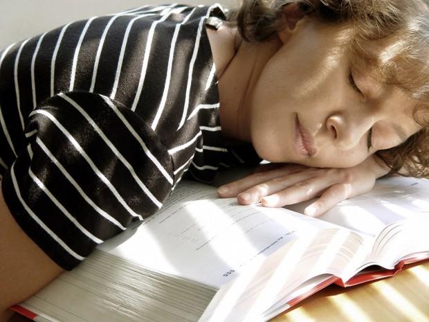 Student falls asleep on textbook