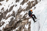 A man rappelling after climbing the ice at the Bridal Veil Falls.
