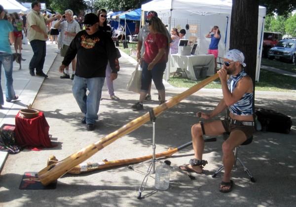 Dan Flynn plays one of his didgeridoos.