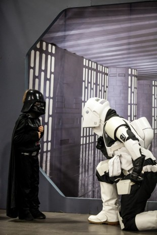 Storm trooper, right, bows to Darth Vader